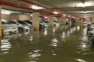 Flooded basement carpark in apartment building